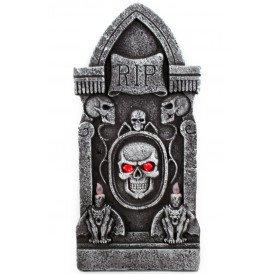 Grafsteen RIP met skelet met licht